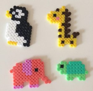 Pinguin, Giraffe, Elefant und Schildkröte gesteckt